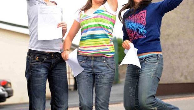A-level students Mairead Hughes, Michelle Rice and Anne McCaul celebrate their results at St Mary's High School in Newry