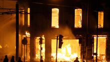 A property on fire near Reeves Corner, Croydon,  as rioters were rampaging across Britain's capital again