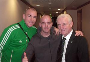 Conor Cunningham (centre) with an unnamed friend (left) and Ireland manager Giovanni Trapattoni (right). Cunningham, 28, from Ballincollig in Co Cork is a self-confessed chancer who blagged his way in to see Ireland qualify for Euro 2012 is hoping lightning strikes twice