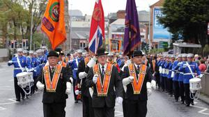 12/7/11 Mandatory Credit Darren Kidd/Presseye.com Orangemen take part in Twelfth of July parades as they make their way to the field at Shaws Bridge, Belfast.The County Grand Lodge Colour Party lead of the parade