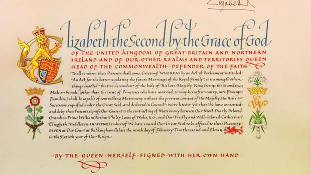 "LONDON - APRIL 21:  A detail of the 'Instrument of Consent', which is the Queen's historic formal consent to Prince William's forthcoming marriage to Catherine Middleton, is displayed at the Crown Office at the House of Lords on April 21, 2011 in London, England. Under the Great Seal of the Realm, Queen Elizabeth signed an elaborate notice of approval which proclaimed, in transcribed calligraphy, consent to the union of ""Our Most Dearly Beloved Grandson Prince William Arthur Philip Louis of Wales, K.G. and Our Trusty and Well-beloved Catherine Elizabeth Middleton"".  (Photo by Clive Gee/WPA Pool/Getty Images)"