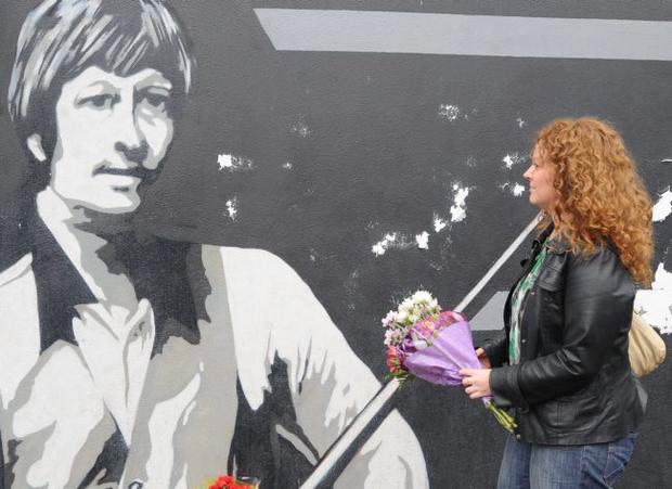 25-7-2010Flowers for Alex Higgins are left at a muralon the Donegal Road  to in honour of the snooker legend who died yesterday in Belfast.