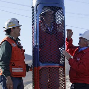 Chile's mining minister Laurence Golborne stands inside a capsule that will be used to rescue trapped miners (AP)