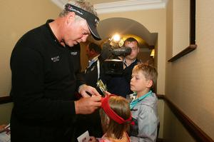 Darren Clarke signs autographs for Ellie and Lewis McCartny