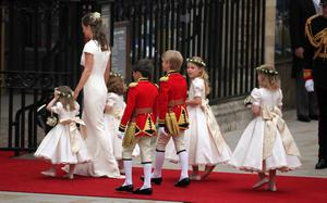 LONDON, ENGLAND - APRIL 29: Pippa Middleton, sister of the bride arrives with the flower girls and page boys at Westmister Abbey on April 29, 2011 in London, England.  The marriage of Prince William, the second in line to the British throne, to Catherine Middleton is being held in London today. The Archbishop of Canterbury conducted the service which was attended by 1900 guests, including foreign Royal family members and heads of state. Thousands of well-wishers from around the world have also flocked to London to witness the spectacle and pageantry of the Royal Wedding and street parties are being held throughout the UK. (Photo by Paul Rogers - WPA Pool/Getty Images)