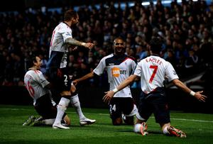 BIRMINGHAM, ENGLAND - APRIL 24:  David Ngog of Bolton Wanderers celebrates with his team mates after scoring his team's second goal during the Barclays Premier League match between Aston Villa and Bolton Wanderers at Villa Park on April 24, 2012 in Birmingham, England.  (Photo by Laurence Griffiths/Getty Images)