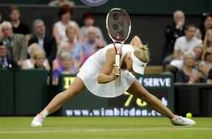 Denmark's Caroline Wozniacki reacts in her match against Austria's Tamira Paszek during day three of the 2012 Wimbledon Championships at the All England Lawn Tennis Club