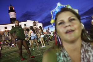 SALVADOR, BRAZIL - FEBRUARY 17: Revelers gather to watch a parade in front of a lighthouse on the second day of Carnival celebrations on February 17, 2012 in Salvador, Brazil. Carnival is the grandest holiday in Brazil, annually drawing millions in raucous celebrations culminating on Fat Tuesday before the start of the Catholic season of Lent which begins on Ash Wednesday. Salvador is the capital of the Northeastern state of Bahia and was the first colonial capital of Brazil.Police strikes in Salvador and Rio de Janiero in recent weeks threatened Carnival and raised questions about the countryÄôs preparedness to host the upcoming 2014 World Cup and 2016 Summer Olympics. Rio de JanieroÄôs Carnival began today, a day later than SalvadorÄôs.  (Photo by Mario Tama/Getty Images)