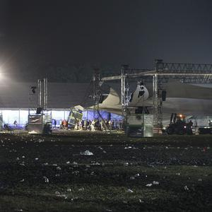 A storm swept through a music festival about 50 miles east of Brussels, Belgium killing at least three people and injuring 70 others (AP Photo/Yves Logghe)
