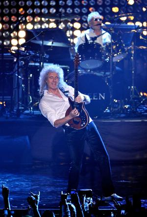BELFAST, NORTHERN IRELAND - NOVEMBER 06:  Brian May of Queen performs onstage during the MTV Europe Music Awards 2011 live show at the Odyssey Arena on November 6, 2011 in Belfast, Northern Ireland.  (Photo by Gareth Cattermole/Getty Images)