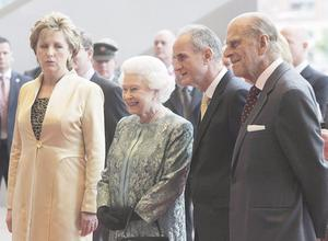 Queen Elizabeth II and the Duke of Edinburgh (right) stand with Irish President Mary McAleese and her husband Dr Martin McAleese (second right) as they arrive for a reception and performance at the Dublin Convention Centre on the third day of the Queen's State visit to Ireland. PRESS ASSOCIATION Photo