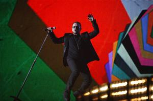 Bono from Irish band U2 performs at the Brit Awards 2009 at Earls Court exhibition centre in London, England, Wednesday, Feb. 18, 2009. (AP Photo/MJ Kim)