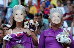 DONETSK, UKRAINE - JUNE 11:  England fans wear, Queen Elizabeth II masks during the UEFA EURO 2012 group D match between France and England at Donbass Arena on June 11, 2012 in Donetsk, Ukraine.  (Photo by Scott Heavey/Getty Images)