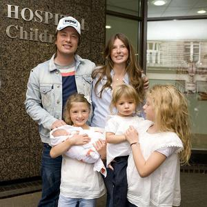 Jools and Jamie Oliver with their four children at the Portland Hospital in London