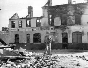 Riots : Belfast. August 1969.  A lone soldier, armed with a sub-machine gun, stands in a pile of rubble beside the shell of a burnt-out public house.  This troublespot is the junction of Hooker Street and Crumlin Road, Belfast.  (18/8/69)