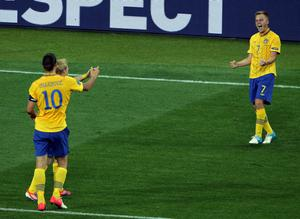 KIEV, UKRAINE - JUNE 19: Sebastian Larsson (R) of Sweden celebrates his goal during the UEFA EURO 2012 group D match between Sweden and France at The Olympic Stadium on June 19, 2012 in Kiev, Ukraine.  (Photo by Ian Walton/Getty Images)