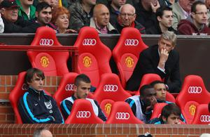 Arsenal manager Arsene Wenger watches his team crash to an 8-2 defeat to Manchester United at Old Trafford in August last year