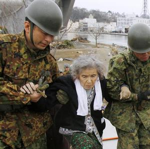 Rescuers continue to pull survivors from the rubble following the earthquake in Japan (AP)