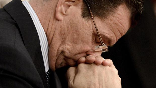 Connecticut Gov. Dannel Malloy bows his head during a moment of silence during a vigil service for victims of the Sandy Hook Elementary School shooting, at the St. Rose of Lima Roman Catholic Church in Newtown, Conn. Friday, Dec. 14, 2012.  (AP Photo/Andrew Gombert, Pool)