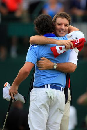BETHESDA, MD - JUNE 19:  Rory McIlroy of Northern Ireland celebrates his eight-stroke with caddie J.P. Fitzgerald victory on the 18th green to win during the 111th U.S. Open at Congressional Country Club on June 19, 2011 in Bethesda, Maryland.  (Photo by David Cannon/Getty Images)