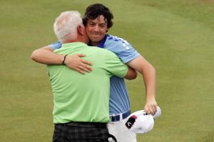 BETHESDA, MD - JUNE 19:  Rory McIlroy of Northern Ireland (R) celebrates his eight-stroke victory with his father Gerry McIlroy (L) on the 18th green during the 111th U.S. Open at Congressional Country Club on June 19, 2011 in Bethesda, Maryland.  (Photo by Ross Kinnaird/Getty Images)