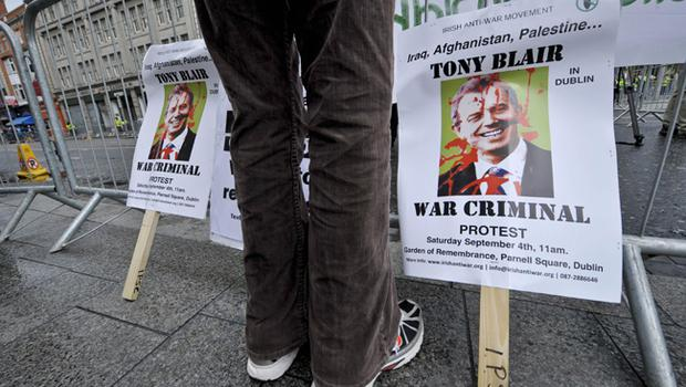 Posters declaring Tony Blair as a war criminal during the former prime minister's book signing at Eason's bookstore in Dublin