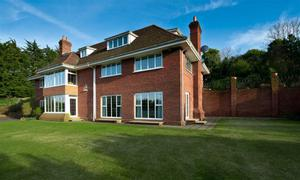 """<b>15. 5 Ballygrainey Road, Holywood, County Down, BT18 0HE For Sale Offers Around £1,250,000</b> The Agents Perspective: """" Designed by local architect Des Ewing, the interior of this distinguished home has formal and informal spaces to discover and enjoy with the heart of the house being a superb hand crafted oak kitchen which opens into a casual dining space and raised living area. """" <p><b>To view property <a href=""""http://www.propertynews.com/Property/Holywood/RBWNRBWN0687/5-Ballygrainey-Road/194686923/Page4"""" title=""""Click here to view property"""">Click here</a> </a></p></b>"""