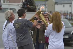 The Olympic torch relay from Larne to Portrush