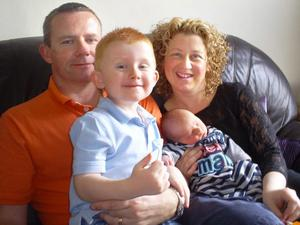 Birth..Joel Cochrane with parents James and Diane and brother                      .