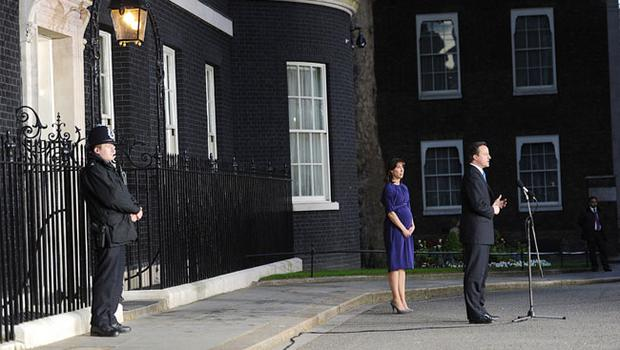 Britain's new Prime Minister David Cameron and his wife, Samantha, stand in Downing Street