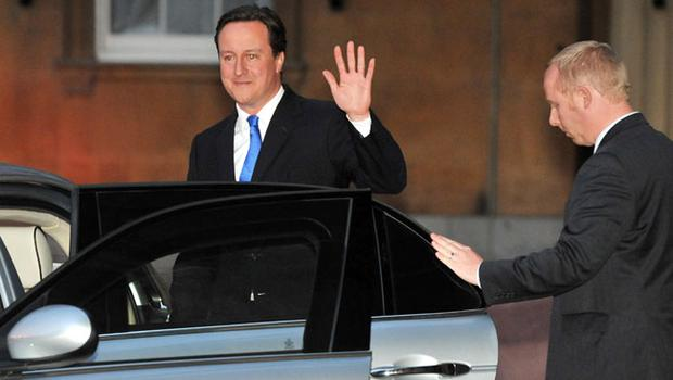 Britain's new Prime Minister David Cameron leaves Buckingham Palace after receiving an invitation from Britain's Queen Elizabeth II to form a new government