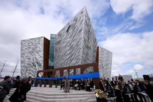 Belfast Lord Mayor Niall O Donnghaile speaks at the opening of Titanic Belfast, the world's largest Titanic-themed attraction in the old shipyard at Harland and Wolff, where the doomed liner was built