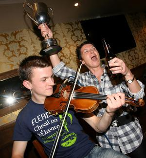 All Ireland champion fiddle player Sean Maguire entertains the folk in Pats bar in Enniskillen with help from his mum Maria Moss.
