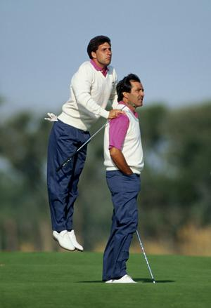 (FILE PHOTO) The family of golfing legend Seve Ballesteros have announced on May 6, 2011 that his health is worsening, following his battle with a brain tumour in 2008.Jose-Maria Olazabal of Spain uses the shoulders of Seve Ballesteros also of Spain to get a better view during the 29th Ryder Cup Matches on 28th September 1991 at Kiawah Island in South Carolina, USA. The USA team defeated Europe with a score of 14.5pts - 13.5pts. (Photo by David Cannon/Getty Images)