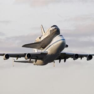 The space shuttle Discovery hitches a ride on top of a 747 carrier jet (AP)
