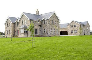 One of the palatial homes owned by Patrick Gerry Small and his wife Mary
