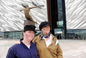 Jenna Scofield (left) and Roberta Sitlington dressed as 'yardmen' to take part in the 'yardmen walk'at Titanic Belast to raise funds for bowel cancer awareness