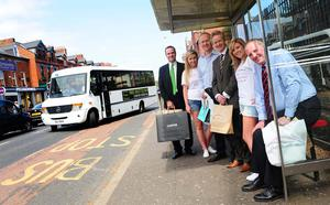Tim Wolstenholme, Paul Maconaghie and Peter Carrington from Lisburn Road Business Association join Councillor Bob Stoker from Belfast City Council's Development Committee to board the new 'Lisburn Road Courtesy Bus'
