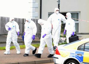 Police forensics experts arrive to examine the area