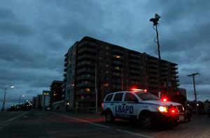 LONG BEACH, NY - OCTOBER 28:  Long Beach police patrol the boardwalk as Hurricane Sandy approaches on October 28, 2012 in Long Beach, New York. Sandy,which has already claimed over 50 lives in the Caribbean is predicted to bring heavy winds and floodwaters to the mid-atlantic region.  (Photo by Mike Stobe/Getty Images)