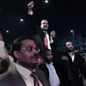Muslim Brotherhood candidate Mohammed el-Beltagi waves to supporters during a rally in Shubra el-Kheima, Cairo