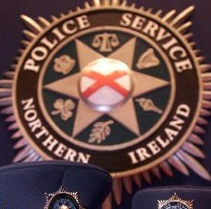 An armed gang shot a man in the leg as they stole weapons from a Belfast house