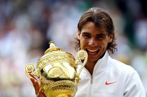 Rafael Nadal of Spain holds the Championship trophy after winning the Men's Singles Final match against Tomas Berdych of Czech Republic