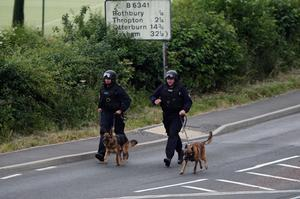Police on the streets of Rothbury, Northumberland as fugitive Raoul Moat lies in a field surrounded by armed officers