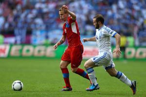 WROCLAW, POLAND - JUNE 12:   David Limbersky of Czech Republic and Dimitris Salpigidis of Greece fight for the ball during the UEFA EURO 2012 group A match between Greece and Czech Republic at The Municipal Stadium on June 12, 2012 in Wroclaw, Poland  (Photo by Clive Mason/Getty Images)