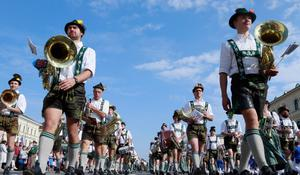 MUNICH, GERMANY - SEPTEMBER 23:  Members of a brass band wearing traditional Bavarian clothes participate in the riflemen's parade during day 2 of the Oktoberfest beer festival on September 22, 2012 in Munich, Germany.This year's edition of the world's biggest beer festival Oktoberfest will run until October 7, 2012.  (Photo by Johannes Simon/Getty Images)