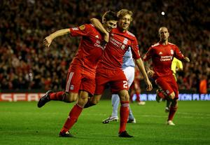 LIVERPOOL, ENGLAND - NOVEMBER 04:  Steven Gerrard of Liverpool celebrates scoring his team's third goal and his hat trick with team mate Lucas (R) during the UEFA Europa League Group K match beteween Liverpool and SSC Napoli at Anfield on November 4, 2010 in Liverpool, England.  (Photo by Clive Brunskill/Getty Images)