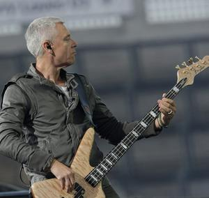 "Adam Clayton of U2 performs live at Croke Park, Dublin on the 1st night of their ""360 degree"" world tour."
