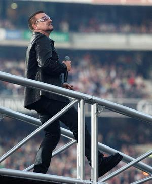 "Bono looks out at the fans in Croke Park, Dublin on the 1st night of U2's ""360 degree"" world tour."