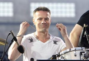 "Drummer Larry Mullen gives a smile to the camera as U2 perform live in Croke Park, Dublin on the 1st night of their ""360 degree"" world tour."